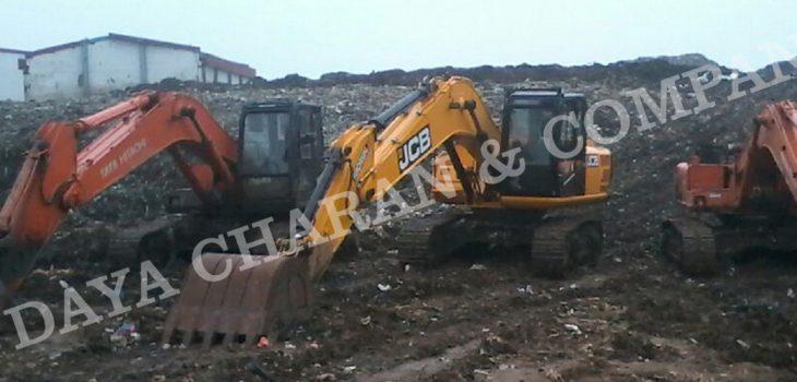 Excavators at landfill waste
